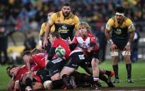 Faf de Klerk of the Lions (2nd R) passes from a ruck during the Super Rugby final match between the Wellington Hurricanes and Lions of South Africa at Westpac Stadium in Wellington on 6 August, 2016. Picture: AFP.