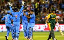 India's Ravichandran Ashwin (2nd R) celebrates with teammates after taking the wicket of South Africa's JP Duminy during the Pool B 2015 Cricket World Cup match between South Africa and India at the Melbourne Cricket Ground (MCG) on 22 February, 2015. Picture: AFP.