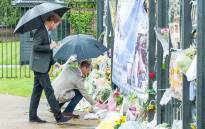 Prince Harry and Prince William lay flowers at the White Garden at the gates of Kensington Palace. Picture: Facebook.com.