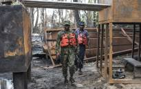 FILE: Members of the Nigerian Navy forces inspect a destroyed illegal oil refinery was on April 19, 2017 in the Niger Delta region near the city of Port Harcourt. Picture: AFP