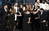 Producer Adele Romanski (C), writer/director Barry Jenkins, producer Jeremy Kleiner and cast/crew members accept Best Picture for 'Moonlight' onstage during the 89th Annual Academy Awards. Picture: AFP