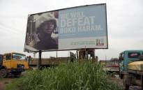 A photo shows a campaign signboad displayed by the ruling All Progressives Congress (APC) to show its readiness to defeat Boko Haram Islamists on assumption office at Ogijo, Ogun State in southwest Nigeria, on 3 July, 2015. Picture: AFP.