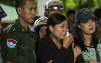 Khine Zin Win (C), who lost her youngest brother and his family, cries during the funeral in Dawei on June 9, 2017. Heavy rains and churning seas hampered search efforts for victims of a military plane crash off Myanmar's southern coast. Picture: AFP