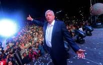 Newly elected Mexico's President Andres Manuel Lopez Obrador, running for Juntos Haremos Historia party, cheers his supporters at the Zocalo Square after winning general elections, in Mexico City, on 1 July 2018. Picture: AFP.