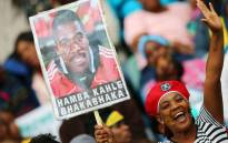 FILE: South African supporters hold a portrait of murdered Bafana Bafana captain and goalkeeper Senzo Meyiwa. Picture: AFP.
