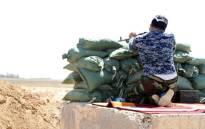 A popular committee fighter supporting Iraqi government forces campaign against jihadist militants from the Islamic State (IS) guards a position in the town of Taza Khurmatu as fighting on the front line continued on 8 August 2014. Picture: AFP.