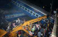 Emergency workers look for survivors on the wreckage of a train carriage after an express train derailed near the town of Khatauli in the Indian state of Uttar Pradesh on August 19, 2017. Picture: AFP.