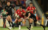 New Zealand All Blacks player Aaron Cruden (R) tackles British and Irish Lions player Ken Owens (C) during their Test match between New Zealand and the British and Irish Lions at Eden Park in Auckland on 24 June, 2017. Picture: AFP.