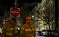 Firefighters put out a major house fire on Prospect Avenue on December 29, 2017 in the Bronx borough of New York City. Over 170 firefighters respond to the evening fire in which at least 12 persons were killed with others injured. Picture: AFP