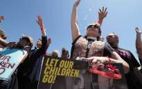 FILE: Protesters pray outside the Otay Mesa Detention Centre during a demonstration against US immigration policy that separates children from parents. Picture: AFP.