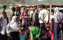 FILE: A UN assessment team talks to displaced people in Pauktaw camp in rural Rakhine, Myanmar, where more than 20,000 Rohingya live. Picture: United Nations