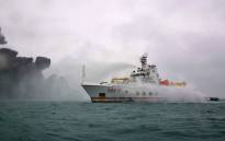 This handout from the Transport Ministry of China taken on January 7, 2018 and released on January 8, 2018 shows the Chinese firefighting vessel 'Donghaijiu 117' spraying water on the burning oil tanker 'Sanchi' at sea off the coast of eastern China. Picture: AFP