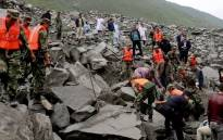 A huge landslide in China has caused massive destruction, with rescue operations going on around the clock. Picture. CNN
