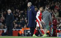 Arsenal's manager Arsene Wenger greets Arsenal's striker Alexis Sanchez after he is substituted during the Uefa Champions League last 16 second leg football match between Arsenal and Bayern Munich at The Emirates Stadium in London on 7 March, 2017. Picture: AFP.