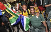 South Africans at the O.R. Tambo International Airport show support to the 2012 Paralympic team on 21 August, 2012. Picture: LEAD SA.