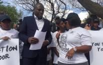 Cosas hand over a memorandum of demands to JSE representative. Picture: Kgothatso Mogale/EWN