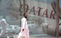 FILE: This photo taken on 5 June 2017 shows a man walking past the Qatar Airways branch in the Saudi capital Riyadh, after it had suspended all flights to Saudi Arabia following a severing of relations between major gulf states and gas-rich Qatar. Picture: AFP