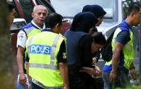 Indonesian national Siti Aishah (R) is escorted by Malaysian police for a court appearance with Vietnamese national Doan Thi Huong (not pictured) at the Sepang magistrates court on 30 May 2017. Picture: AFP
