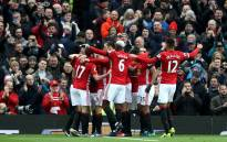 FILE: Manchester United players celebrate during a match. Picture: Twitter/@ManUtd.