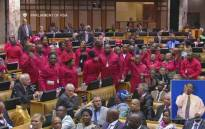 A screengrab of Economic Freedom Fighters MPs seen in Parliament before being removed.