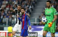 Juventus defender Leonardo Bonucci speaks to Barcelona's Lionel Messi during their Uefa Champions League match. Picture: AFP.