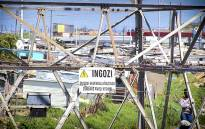 FILE: A sign warning of high electrical current hangs redundantly on a pylon in Khayelitsha as wires from illegal connections run around it. Picture: Thomas Holder/EWN.