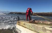 NSRI team searches for four men after their boat capsized. Picture: NSRI.