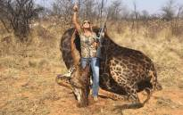 This photo shows US hunter Tess Thompson Talley posing with body of a giraffe she  killed in South Africa. Picture: facebook.com
