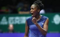 Venus Williams celebrates during her group stage match with Latvia's Jelena Ostapenko. Picture: @WTA/Twitter.