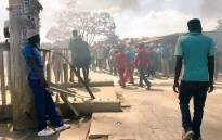 Despite JMPD's attempts to restore order after the community barricaded the road, Zandspruit residents continue to burn tyres. Picture: Hitekani Magwedze/EWN.