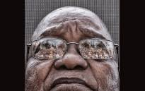 The crowd that gathered to support former President Jacob Zuma is seen reflected in his glasses as he waits to speak after appearing on corruption charges at the Durban High Court, South Africa. Picture: Ihsaan Haffejee/EWN.