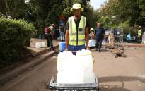 Jameel Saalie started working as a water porter a moth ago after losing his job. Water porters at a natural spring in Newlands help push trollies of water buckets to cars for any loose change. Picture: Bertram Malgas/EWN