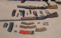 SAPS recovered firearms and ammo; 2 arrested, guns during ops in Nkumandeni. Picture: Twitter @SAPoliceService