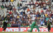 Pakistan's Umar Akmal is bowled out as Australia's wicketkeeper Peter Nevill (L) looks on during the World T20 cricket tournament match between Australia and Pakistan at The Punjab Cricket Stadium Association Stadium in Mohali on 25 March 2016. Picture: AFP.