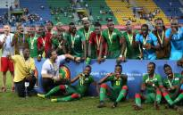Burkina Faso's players and Burkina Faso's Portuguese coach Paulo Duarte celebrate with their bronze medals at the end of the 2017 Africa Cup of Nations third place football match between Burkina Faso and Ghana in Port-Gentil on 4 February, 2017. Picture: AFP.