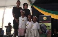 Sindiso Magaqa's children on stage. Magaqa'a niece Yolokazi spoke on behalf of the children. Picture: Ziyanda Ngcobo/EWN.