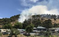 A fire on the slopes of Signal Hill close to residential properties. Picture: Monique Mortlock/EWN