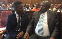 Victor Mlotshwa with his his lawyer ahead of the court proceedings in Middelburg Magistrates Court. Ziyanda Yono/EWN