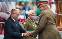 President Jacob Zuma hands over a medal at the 'SS Mendi' memorial services in Durban. Picture: Thomas Holder/EWN.