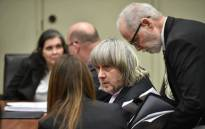 David and Louise Turpin with attorneys David Macher (R) and Jeff Moore (2nd L) are seen during their court arraignment in Riverside, California on 18 January, 2018. Picture: AFP