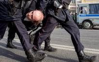 Police officers detain a man during an unauthorised anti-corruption rally in central Moscow on 26 March, 2017. Picture: AFP.
