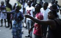 Angry voters at the SG Angola Libre school in the Makelele district of Brazzaville react while the ballots were counted in the polling station at the end of the vote for the presidential election on 20 March, 2016. Picture: AFP.