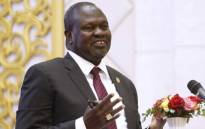 """FILE: South Sudanese rebel leader Riek Machar speaks during the ceremony after the two South Sudanese arch-foes agreed in Khartoum on 27 June, 2018, to a """"permanent"""" ceasefire to take effect within 72 hours in their country. Picture: AFP"""
