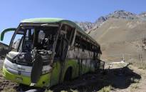 A view of the bus that overturned, leaving at least 19 of the 40 passengers dead and more than 20 injured, near the town of Uspallata in the western Argentine province of Mendoza on its way to Chile, early in the morning of February 18, 2017. Picture: AFP.