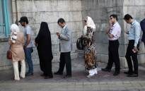 Iranians queue to cast their votes. Picture: AFP