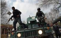 Afghan policemen leap from a vehicle as they arrive at the site of an explosion in Kabul on 8 March 2017. Picture: AFP.