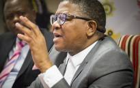 Police Minister Fikile Mbalula leaves a media briefing at the Hawks head office in Pretoria where embattled head Berning Ntlemeza defied a court order and reported for duty on 24 April 2017. Picture: Reinart Toerien/EWN