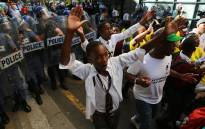 FILE: Police officers seen among protesting Cosas members in Cape Town's CBD. Picture: Thomas Holder/EWN.