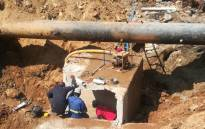Workers do repairs on the burst water pipe in Sandton on 22 November 2017. Picture: @NicoDeJager64/Twitter