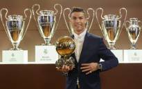 Cristiano Ronaldo posing with the Ballon d'Or France Football trophy at the Santiago Bernabeu stadium in Madrid. Picture: AFP.